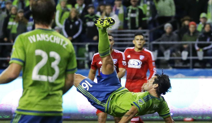 Seattle Sounders forward Nelson Valdez (16) tries a bicycle kick near the FC Dallas goal in the second half of an MLS soccer western conference semifinal playoff match, Sunday, Nov. 1, 2015, in Seattle. The Sounders beat FC Dallas 2-1 in the first of two aggregate-score matches. (AP Photo/Ted S. Warren)