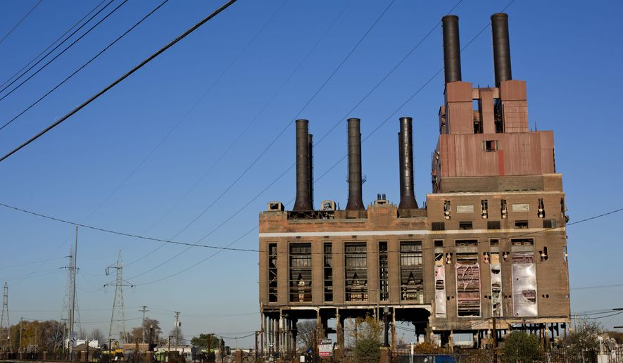 The former DTE power plant pictured Wednesday, Nov. 4, 2015 in Marysville. The structure will be imploded at 8 a.m. Saturday. (Jeffrey M. Smith/The Times Herald via AP)  NO SALES; MANDATORY CREDIT