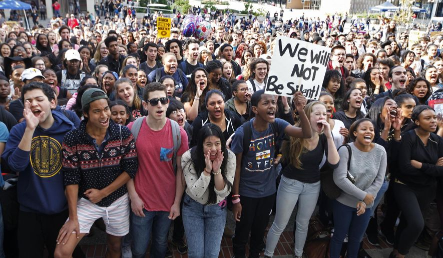 Berkeley High School students yell around Sproul Plaza at UC Berkeley for a rally against racism in Berkeley, Calif., on Thursday, Nov. 5, 2015. Berkeley High School students walked out of class Thursday in protest of a racist message left on a computer screen a day earlier, district officials said. (Laura A. Oda/Bay Area News Group via AP) MANDATORY CREDIT