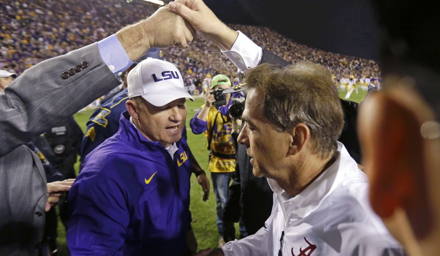 FILE - In this Nov. 8, 2014, file photo, LSU coach Les Miles, left, shakes hands with Alabama coach Nick Saban after an NCAA college football game in Baton Rouge, La. No. 4 LSU and No. 7 Alabama will play Saturday, Nov. 7, 2015, in Tuscaloosa, Ala.  (AP Photo/Gerald Herbert, File)