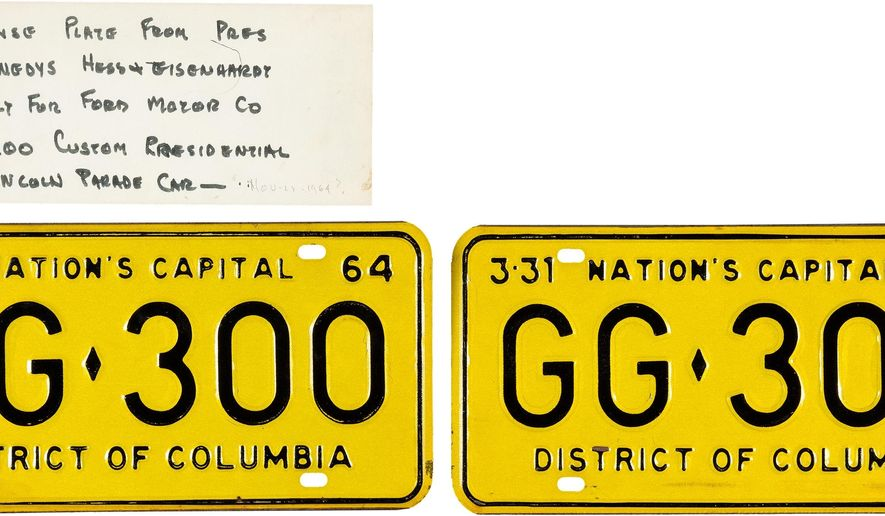 This undated photo provided by Heritage Auction shows the license plates that were on the limousine carrying President John F. Kennedy when he was assassinated in Dallas on Nov. 22, 1963. The plates, which were discarded when the vehicle was sent for upgrades, are going up for auction. (Heritage Auctions via AP Photo)