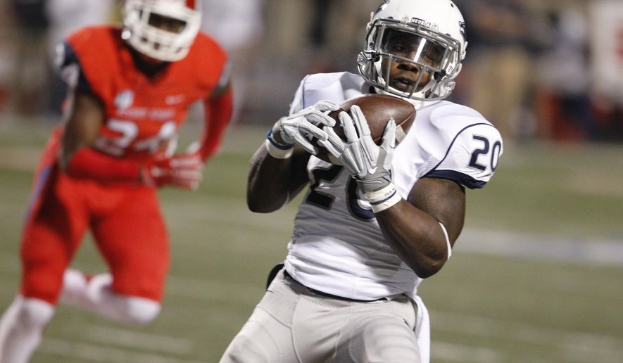 Nevada''s James Butler catches a passes for a long gain as Fresno State's George Helmuth chases during the first half of an NCAA college football game in Fresno, Calif., Thursday, Nov. 5, 2015. (AP Photo/Gary Kazanjian)