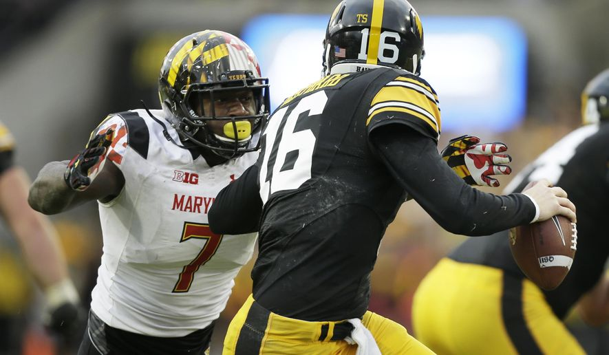 In this Saturday, Oct. 31, 2015, photo, Maryland defensive lineman Yannick Ngakoue, left, chases Iowa quarterback C.J. Beathard during the second half of an NCAA college football game, in Iowa City, Iowa. After doing a decent job stopping the run against Iowa last weekend, Maryland's defense is poised for an even stiffer challenge Saturday against Wisconsin. (AP Photo/Charlie Neibergall)