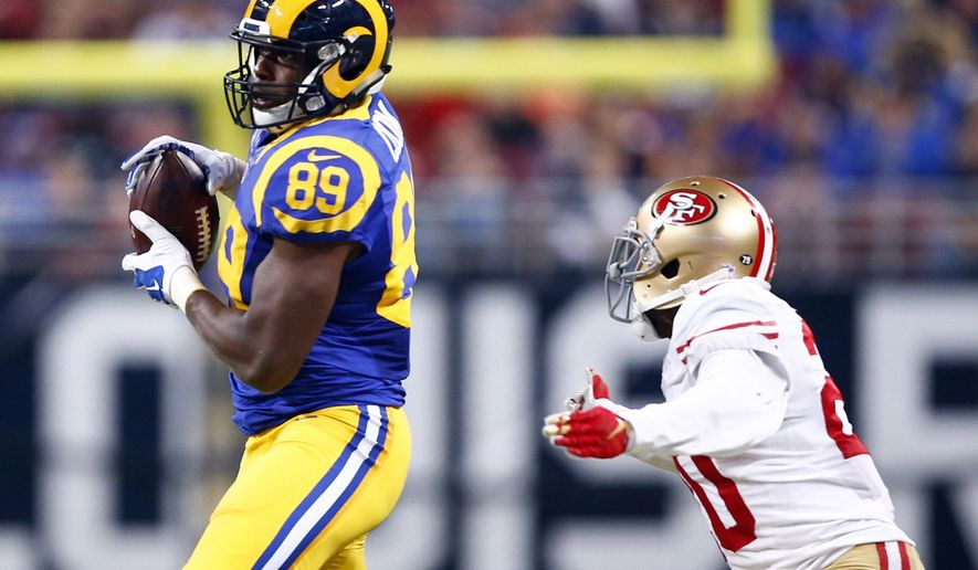 St. Louis Rams tight end Jared Cook, left, catches a 49-yard pass as San Francisco 49ers cornerback Kenneth Acker defends during the second quarter of an NFL football game, Sunday, Nov. 1, 2015, in St. Louis. (AP Photo/Billy Hurst)
