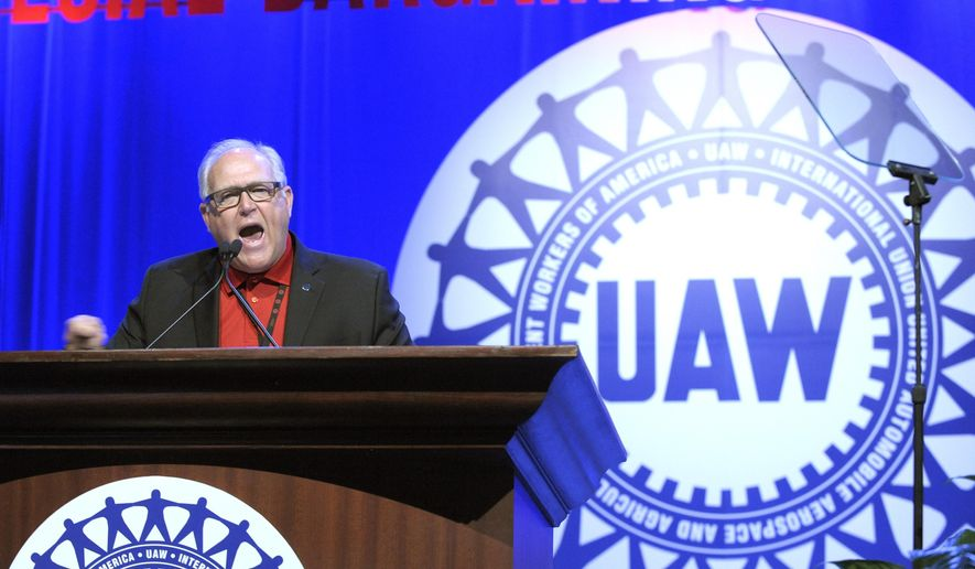FILE - In this Wednesday, March 25, 2015 file photo, United Auto Workers President Dennis Williams addresses UAW members in Detroit.  UAW  members at General Motors appear poised to approve a new four-year contract with the company. Workers at two union locals at a huge factory in Lordstown, Ohio, east of Cleveland, and at an SUV assembly plant near Lansing, Michigan, voted overwhelmingly for the deal on Friday, Nov 6, 2015.  (Todd McInturf/Detroit News via AP)  DETROIT FREE PRESS OUT; HUFFINGTON POST OUT; MANDATORY CREDIT