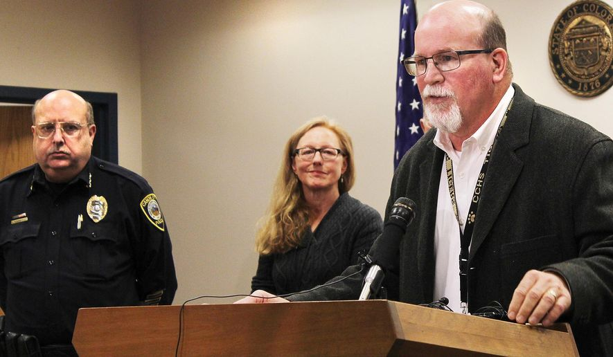 Canon City Police Chief Paul Schultz, left, and Crime Prevention Coordinator Jen O'Connor listen as Superintendent George Welsh talks about a sexting scandal at Canon City High School during a news conference in Canon City, Colo., on Friday, Nov. 6, 2015. An unspecified number of students have been suspended and the school forfeited its final football game of the season because of the number of players involved. (Tracy Harmon/The Pueblo Chieftain via AP)