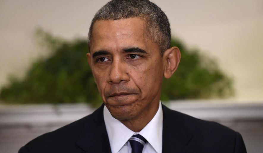 After years of saying he didn't have the power to unilaterally grant a broad amnesty, and after his party was clobbered in the 2014 congressional elections, President Obama reversed himself and decided he did have the power to broaden his deportation amnesty. (Associated Press/File)