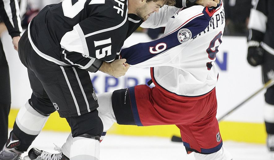 Los Angeles Kings' Andy Andreoff, left, fights with Columbus Blue Jackets' Gregory Campbell during the second period of an NHL hockey game, Thursday, Nov. 5, 2015, in Los Angeles. (AP Photo/Jae C. Hong)