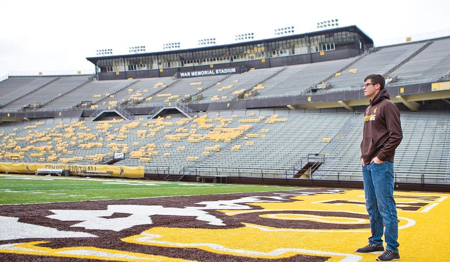 In this photo taken Oct. 21, 2015, Tristen Eichbush poses for a photo at War Memorial Stadium in Laramie, Wyo. Eichbush, aormer Laramie receiver who was walk on player at the University of Wyoming football team this year, has decided to leave the game behind after a series of concussions. (Jeremy Martin/Laramie Daily Boomerang via AP) MANDATORY CREDIT