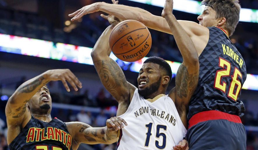 New Orleans Pelicans forward Alonzo Gee (15) is stopped as he goes to the basket between Atlanta Hawks forward Mike Scott (32) and guard Kyle Korver (26) in the first half of an NBA basketball game in New Orleans, Friday, Nov. 6, 2015. (AP Photo/Gerald Herbert)