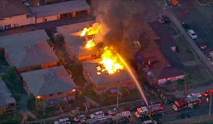 In this image taken from video provided by KABC-TV, Firefighters battle a blaze at two apartment complexes, Friday morning, Nov.  6, 2015, in Anaheim, Calif. Two Anaheim apartment buildings will probably be a total loss after fire raced through them and displaced over 40 people. (KABC-TV via AP)  MANDATORY CREDIT. TV OUT