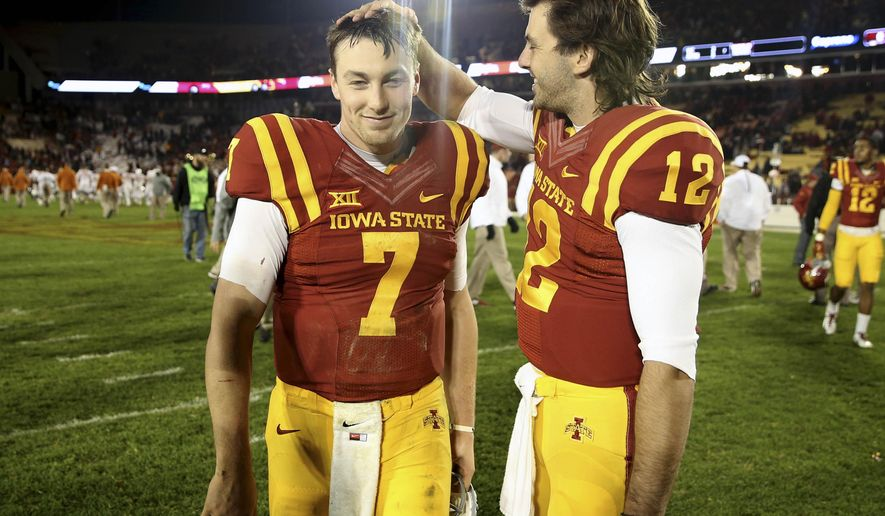 Iowa State starting quarterback Joel Lanning (7) is congratulated by Iowa State backup quarterback Sam B. Richardson (12) after a 24-0 victory over Texas during an NCAA college football game, Saturday, Oct. 31, 2015, in Ames, Iowa. It was Lanning's first career start. (AP Photo/Justin Hayworth)