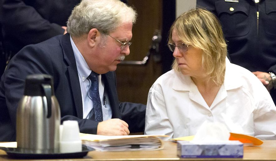 Attorney Steven Johnston, left, confers with Joyce Mitchell, a former prison employee who provided the tools that two murderers used to cut their way out of a maximum-security facility in northern New York, during a restitution hearing at the Clinton County Government Center, Friday, Nov. 6, 2015, in Plattsburgh, N.Y.  Mitchell's will pay $79,841, plus a 10 percent surcharge, for the damage Richard Matt and David Sweat caused by using hacksaw blades and other tools she provided to break out of Clinton Correctional Facility in June, a prosecutor said. (Gabe Dickens/Press-Republican via AP) MANDATORY CREDIT