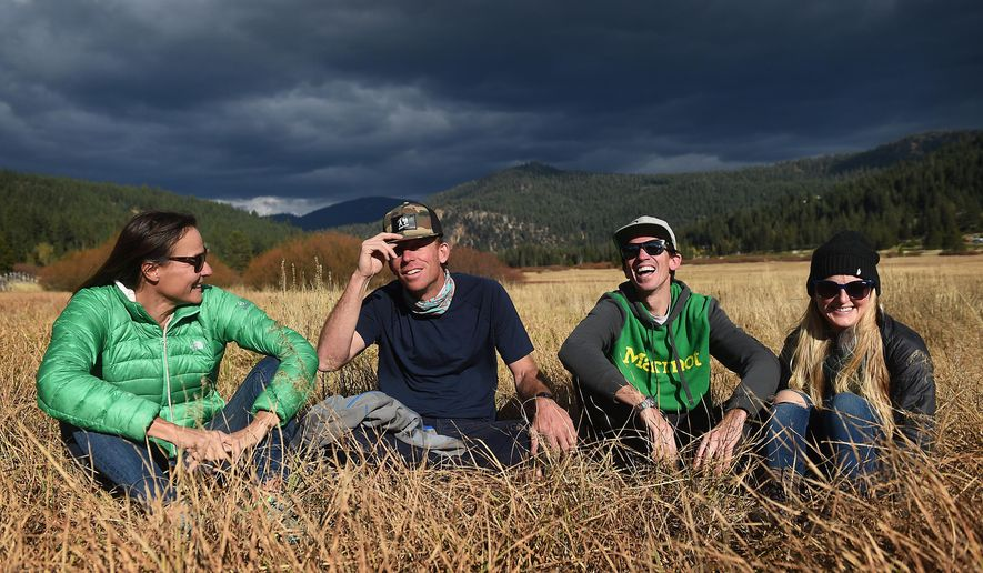 ADVANCE FOR THE WEEKEND OF NOV. 7-8 AND THEREAFTER - In a Oct. 19, 2015 photo, from left, ski mountaineers Hilaree O'Neill, Jim Morrison, Adrian Ballinger and Emily Harrington pose for a group portrait in a meadow at Squaw Valley, Calif. The four were members of a recent ski-mountaineering expedition on Makalu, the fifth highest peak in the world. (Jason Bean/The Reno Gazette-Journal via AP)  NO SALES; NEVADA APPEAL OUT; SOUTH RENO WEEKLY OUT; MANDATORY CREDIT
