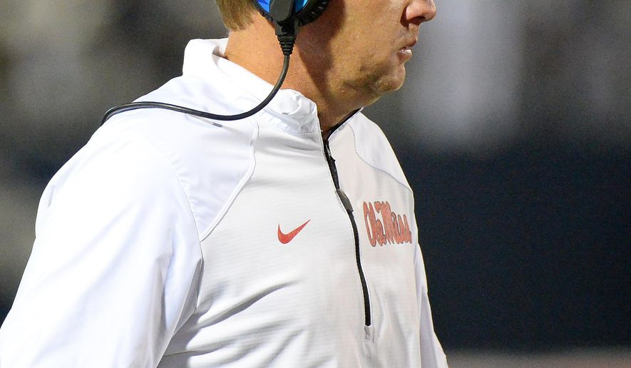Mississippi head coach Hugh Freeze watches on from the sideline during the second half of an NCAA college football game against Arkansas in Oxford, Miss., Saturday, Nov. 7, 2015. Arkansas won 53-52 in overtime. (AP Photo/Thomas Graning)
