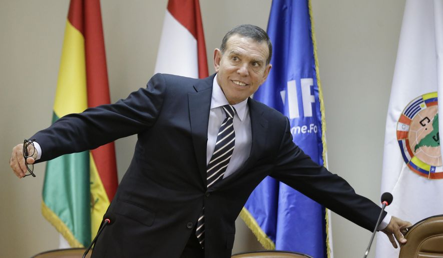 FILE.- In this May 21, 2015 file photo, Conmebol President Juan Angel Napout arrives for a news conference in Asuncion, Paraguay. Napout says the election of a new FIFA president to replace Sepp Blatter is important but won't solve all troubles engulfing FIFA, and therefore soccer bosses must work together to come out of the worst crisis in the history of the world's most popular sport.(AP Photo/Jorge Saenz, File)