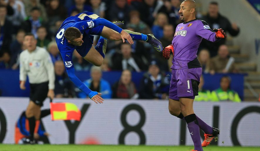 Leicester City's Jamie Vardy, left, is awarded a penalty after being brought down by Watford goalkeeper Heurelho Gomes, during the English Premier League soccer match between Leicester and Watford, at King Power Stadium, in Leicester, England, Saturday, Nov. 7, 2015.  (Nigel French/PA via AP) UNITED KINGDOM OUT