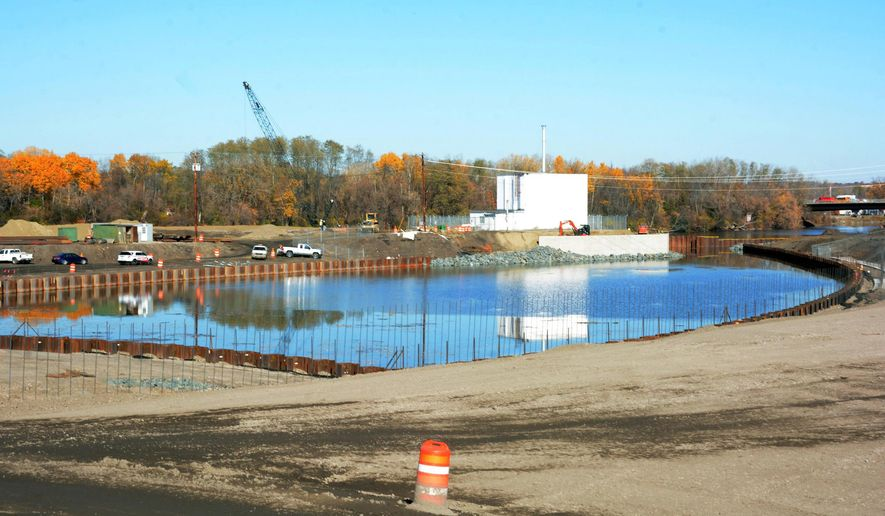 In this Nov. 3, 2014 photo, waters of the Mohawk River are let into the new harbor area at the Rivers Casino & Resort at Mohawk Harbor in Schenectady, N.Y. Nearly a year after three casino projects in New York were chosen as part of a plan to boost the upstate economy, those projects are still awaiting casino license following delays caused by bureaucratic red tape and, in one case, lawsuits from local opponents. (Marc M. Schultz/Schenectady Daily Gazette via AP)  TROY, SCHENECTADY; SARATOGA SPRINGS; ALBANY AND AMSTERDAM OUT; MANDATORY CREDIT