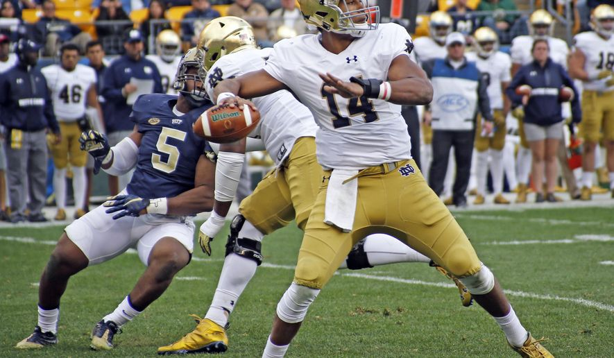 Notre Dame quarterback DeShone Kizer (14) looks to pass as Pittsburgh defensive lineman Ejuan Price (5) rushes in the second quarter of an NCAA football game, Saturday, Nov. 7, 2015 in Pittsburgh. (AP Photo/Keith Srakocic)