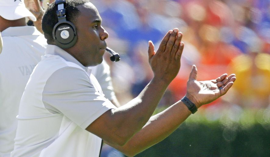Vanderbilt head coach Derek Mason encourages his team during the first half of an NCAA college football game against Florida , Saturday, Nov. 7, 2015, in Gainesville, Fla. (AP Photo/John Raoux)