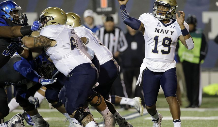 Navy quarterback Keenan Reynolds (19) passes against Memphis in the first half of an NCAA college football game Saturday, Nov. 7, 2015, in Memphis, Tenn. (AP Photo/Mark Humphrey)