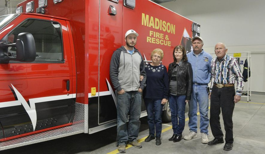 ADVANCE FOR SATURDAY, NOV. 7 - In this photo taken Oct. 30, 2015, from left, Jesse Orlowski, Jerilyn Orlowski, Brenda Orlowski, John Orlowski Jr., and John Orlowski pose for a photo at the Madison Volunteer Fire Department in Madison, Neb. First responders often refer to their colleagues as family. Sometimes, the term brotherhood is used. At the volunteer fire department and emergency medical services (EMS) in Madison, it's not uncommon that such endearments are literal. Like many other rescue personnel in this town, the Orlowski family has a multi-generation volunteer service record.  (Jake Wragge/The Norfolk Daily News via AP)  MANDATORY CREDIT