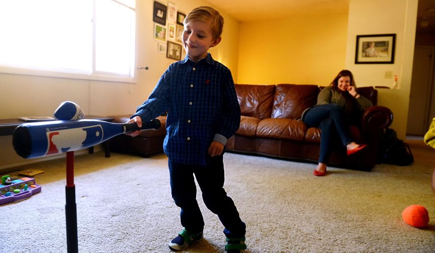 "ADVANCE FOR THE WEEKEND OF NOV. 14-15 AND THEREAFTER - In an Oct. 21, 2015 photo, Jack Bennion, 6, is shown with his mother Jessi at their home in Clancy, Mont. Jack, who is in kindergarten this year, was born with cerebral palsy and suffers from the effects of hydrocephalus. His father Jon wrote a children's book called ""The Adventures of Jackpants!"" to help Jack's classmates understand his condition. (Rion Sanders/Great Falls Tribune via AP)"