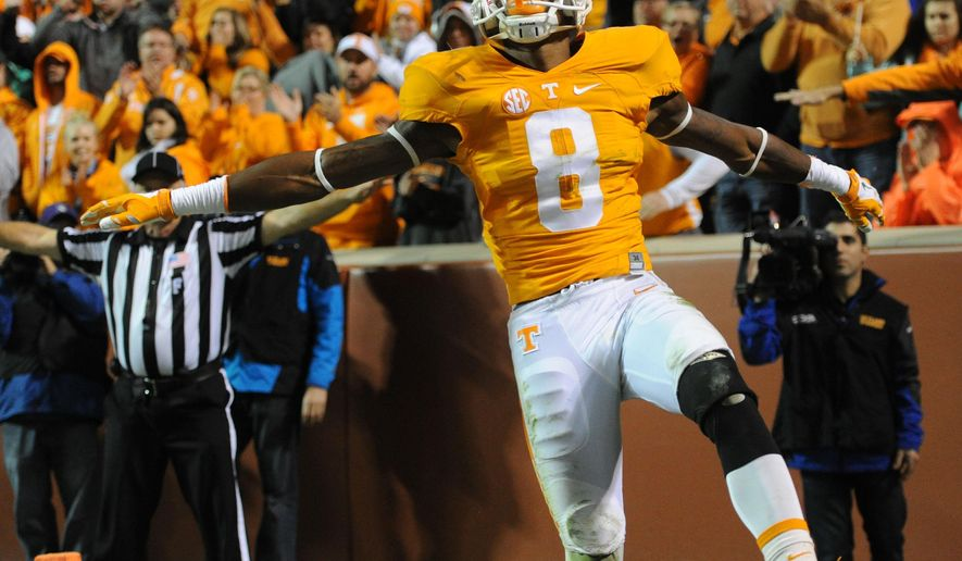 Tennessee defensive back Justin Martin (8) motions after breaking up a pass by South Carolina during the second half of an NCAA college football game at Neyland Stadium in Knoxville, Tenn. on Saturday, Nov. 7, 2015. (Adam Lau/Knoxville News Sentinel via AP)