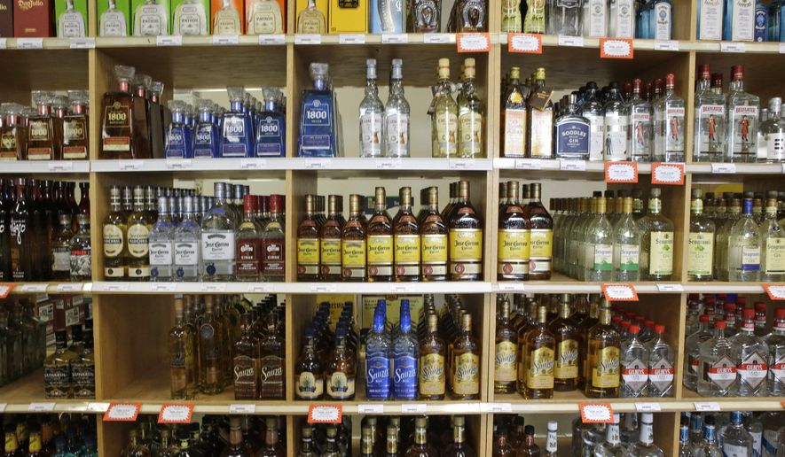 FILE - This July 29, 2014, file photo, shows bottles of liquor at a Utah State Liquor Store in Salt Lake City. New state figures show alcohol sales in Utah increased again in 2015. Data released by the Utah Department of Alcoholic Beverage Control show $396 million in total sales were made in fiscal 2015, which ended June 30. That figure marks an 8 percent rise from 2014 and is more than double a decade ago. (AP Photo/Rick Bowmer, File)