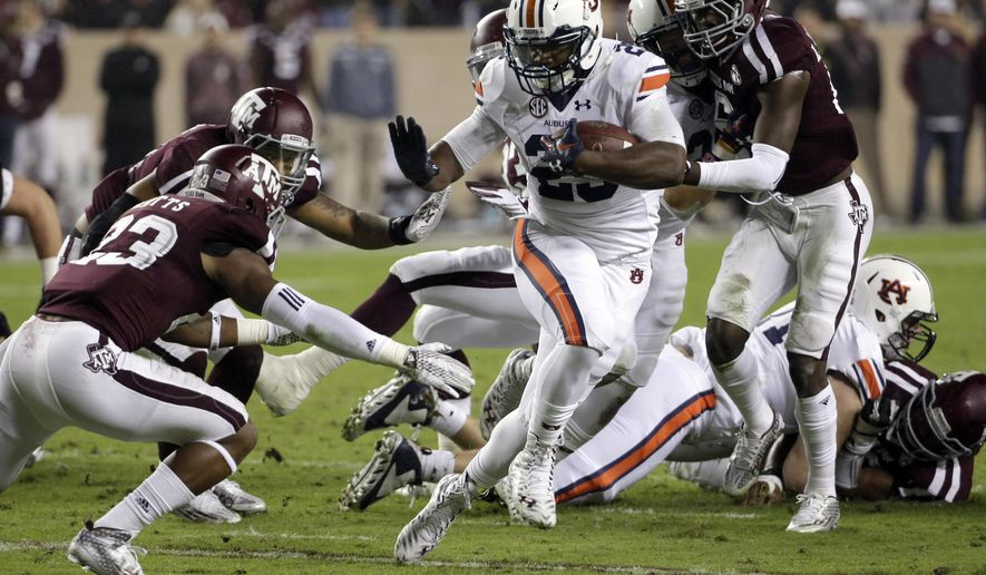 Auburn running back Jovon Robinson (29) breaks away from Texas A&M defensive back Armani Watts (23) during the first quarter of an NCAA college football game, Saturday, Nov. 7, 2015, in College Station, Texas. (AP Photo/David J. Phillip)
