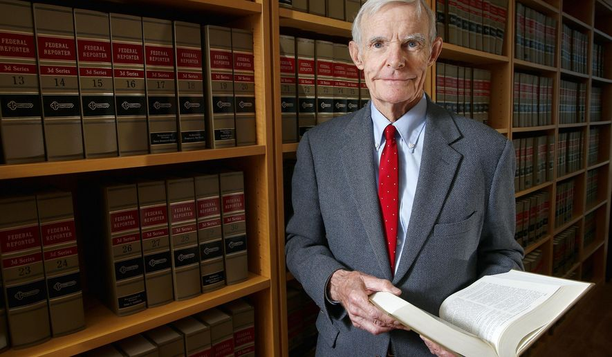 Judge William Canby is photographed in his office, Wednesday, Nov. 4, 2015 in Phoenix. The 84 federal appellate court made the difficult decision a few years ago to mostly stop hearing cases after a 30-year career. He was sharp and healthy, but didn't want to risk mental decline that would lead him to make mistakes, he said. (AP Photo/Ross D. Franklin)