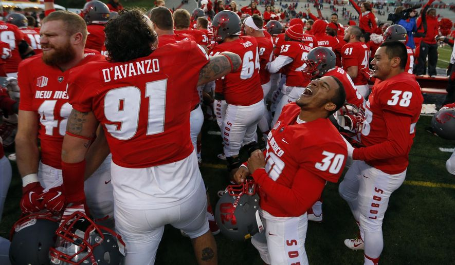 New Mexico running back Wendell Carter (30) and his teammates celebrate their 14-13 victory over Utah State in an NCAA college football game in Albuquerque, N.M., Saturday, Nov. 7, 2015. (AP Photo/Andres Leighton)