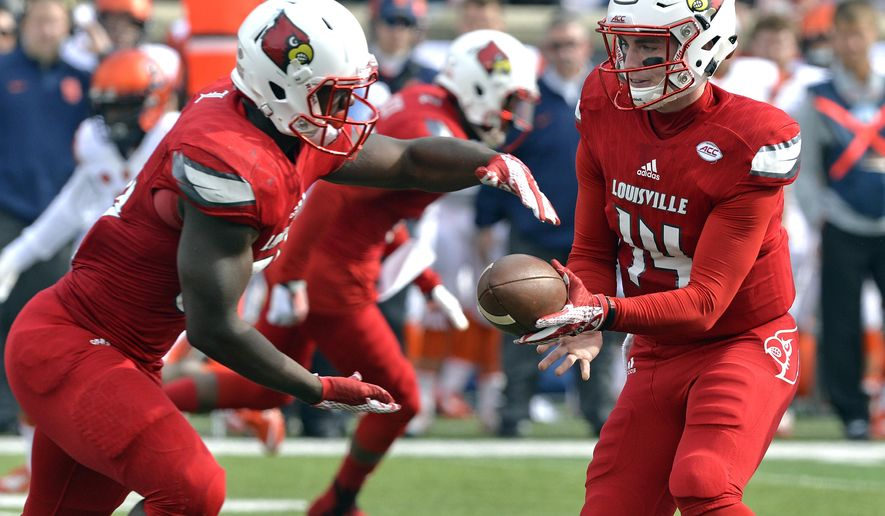 Louisville quarterback Kyle Bolin (14) makes a hand-off to running back Jeremy Smith (340 during the first half of an NCAA college football game against Syracuse, Saturday, Nov. 7, 2015, in Louisville, Ky. (AP Photo/Timothy D. Easley)