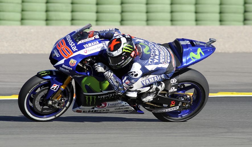 Spanish rider Jorge Lorenzo rides during a qualifying session for Sunday's Valencia Motorcycle Grand Prix, the last race of the season, at the Ricardo Tormo circuit in Cheste near Valencia, Spain, Saturday Nov. 7, 2015. (AP Photo/ Eduardo Manzana)