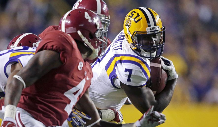 FILE - In this Nov. 8, 2014, file photo, LSU running back Leonard Fournette (7) carries in the first half of an NCAA college football game against Alabama in Baton Rouge, La. One of the best fronts in the country takes on the nation's leading rusher and Heisman Trophy candidate when Alabama and LSU meet Saturday, Nov. 7, 2015. (AP Photo/Gerald Herbert, File)