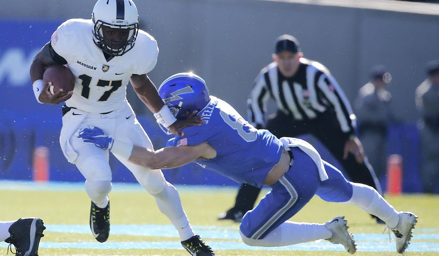 Army quarterback Ahmad Bradshaw (17) is tackled by Air Force defensive back Weston Steelhammer (8) during the first half of an NCAA college football game at Air Force, Academy, Colo., Saturday, Nov. 7, 2015. (AP Photo/Jack Dempsey)