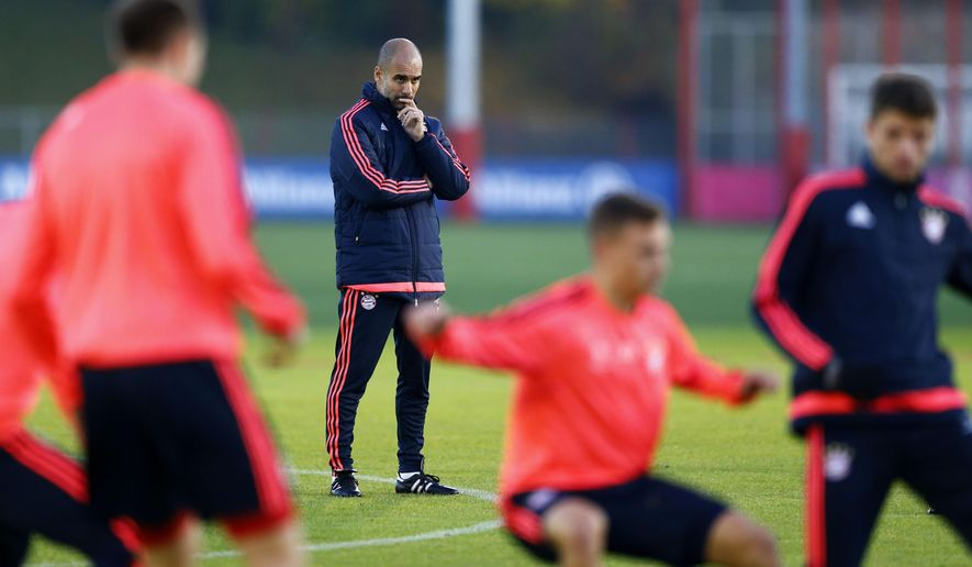 Bayern's head coach Pep Guardiola watches his team during a training session prior to the Champions League Group F soccer match against  FC Arsenal in Munich, Germany, Tuesday Nov. 3, 2015. Bayern will face Arsenal Wednesday. (AP Photo/Matthias Schrader)