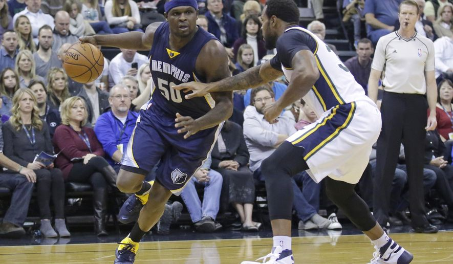 Memphis Grizzlies forward Zach Randolph (50) drives around Utah Jazz forward Trevor Booker, right, in the second quarter during an NBA basketball game Saturday, Nov. 7, 2015, in Salt Lake City. (AP Photo/Rick Bowmer)