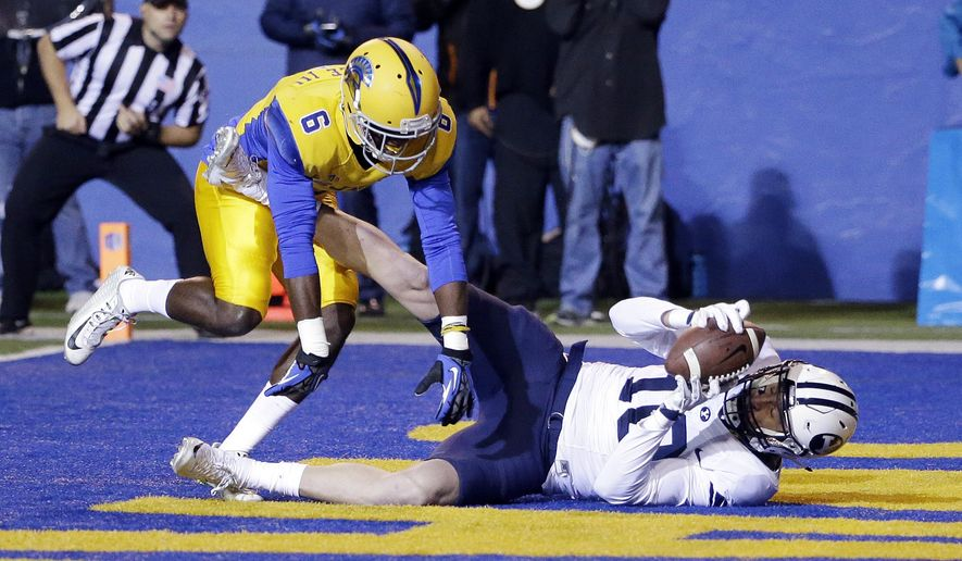 BYU's Mitch Mathews (10) grabs a touchdown pass next to San Jose State cornerback Cleveland Wallace III (6) during the first half of an NCAA college football game Friday, Nov. 6, 2015, in San Jose, Calif. (AP Photo/Marcio Jose Sanchez)