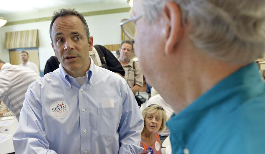 FILE - In this Aug. 1, 2015, file photo, Kentucky Republican gubernatorial candidate Matt Bevin, left, speaks with Kentucky Senator Mitch McConnell at the Graves County Republican Party breakfast in Mayfield, Ky. McConnell says the GOP has done a lot to build support in Kentucky, where Bevin was elected governor on Tuesday, Nov. 3. But as for the switch in the coal counties that for so long backed Democrats, he gives all the credit to President Barack Obama. (AP Photo/Timothy D. Easley, File)