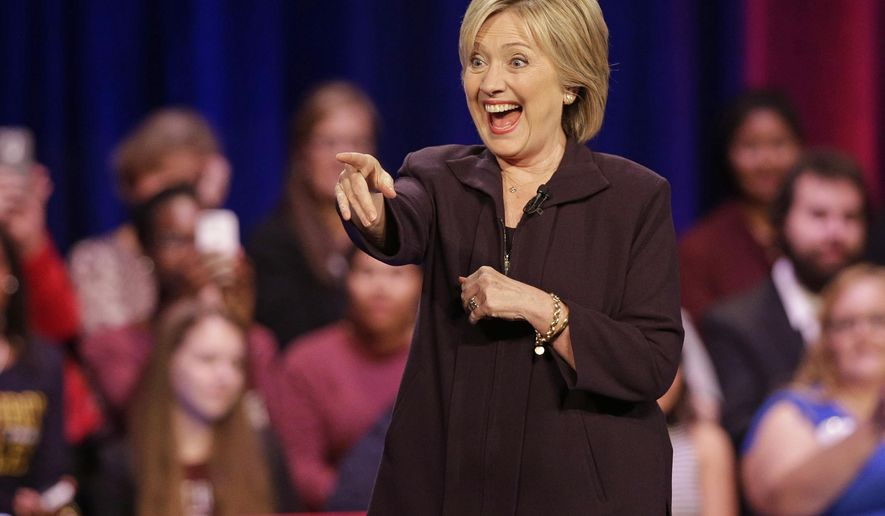 Democratic presidential candidate Hillary Rodham Clinton points to the crowd after a democratic presidential candidate forum at Winthrop University in Rock Hill, S.C., Friday, Nov. 6, 2015. (AP Photo/Chuck Burton)