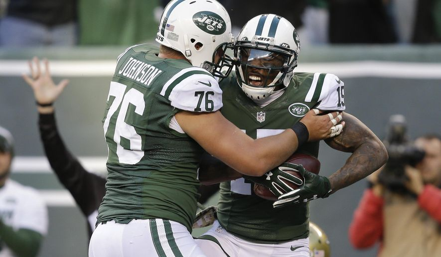 New York Jets wide receiver Brandon Marshall (15) celebrates with New York Jets center Wesley Johnson (76) after scoring a touchdown against Jacksonville Jaguars during the fourth quarter of an NFL football game, Sunday, Nov. 8, 2015, in East Rutherford, N.J. (AP Photo/Seth Wenig)