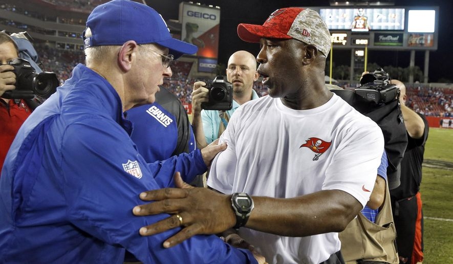 Tampa Bay Buccaneers head coach Lovie Smith, right, congratulates New York Giants head coach Tom Coughlin after the Giants defeated the Buccaneers 32-18 during an NFL football game Sunday, Nov. 8, 2015, in Tampa, Fla. (AP Photo/Brian Blanco)