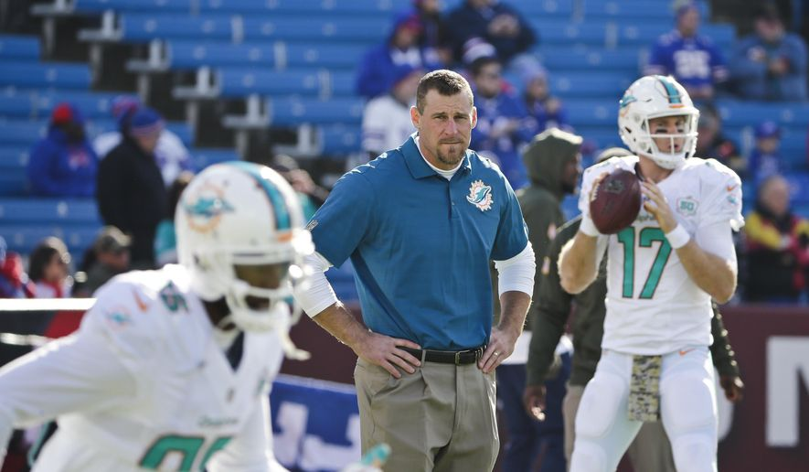 Miami Dolphins head coach Dan Campbell, center, watches his team warm up as quarterback Ryan Tannehill (17) throws a pass before an NFL football game against the Buffalo Bills, Sunday, Nov. 8, 2015, in Orchard Park, N.Y. (AP Photo/Bill Wippert)