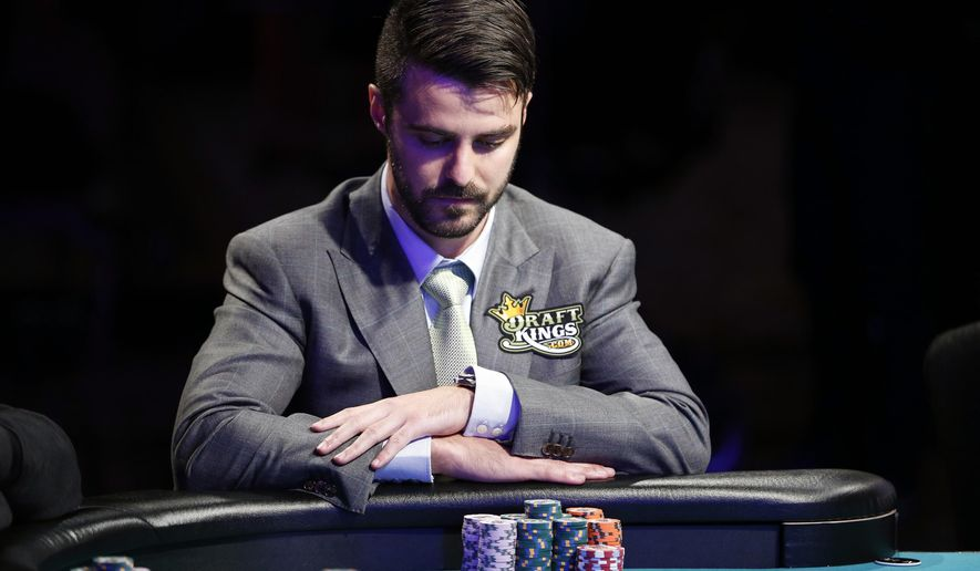 FILE - In this July 14, 2015, file photo, Max Steinberg plays at the World Series of Poker Main Event in Las Vegas. The Main Event returns Sunday, Nov. 8, with nine players competing in a three-day marathon for a $7.6 million prize to the victor. (AP Photo/John Locher, File)