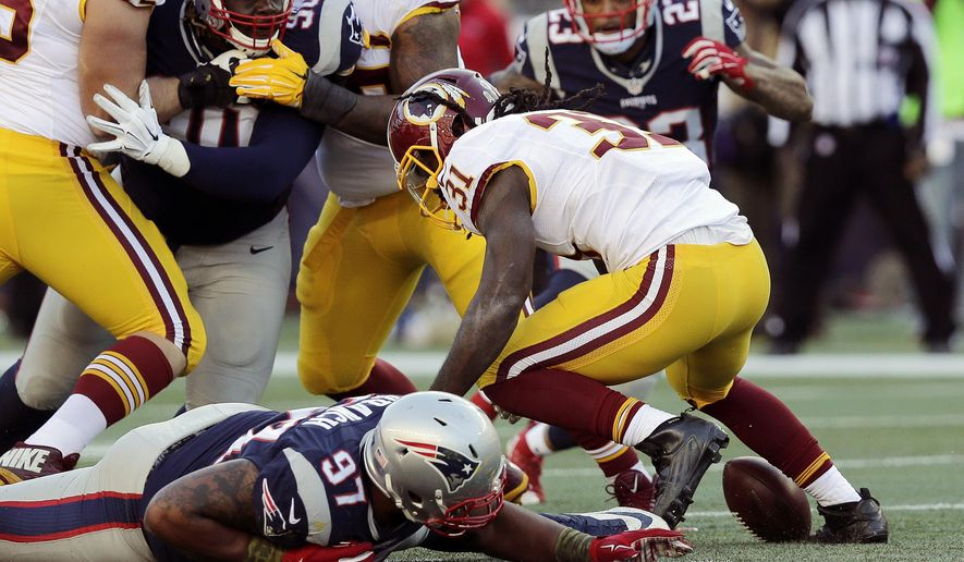 Washington Redskins running back Matt Jones (31) fumbles during the second half of an NFL football game against the New England Patriots, Sunday, Nov. 8, 2015, in Foxborough, Mass. (AP Photo/Charles Krupa)
