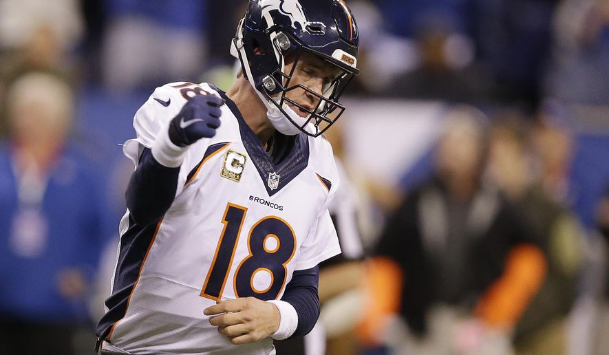 Denver Broncos quarterback Peyton Manning celebrates a 1-yard touchdown during the second half of an NFL football game against the Indianapolis Colts, Sunday, Nov. 8, 2015, Indianapolis. (AP Photo/Michael Conroy)