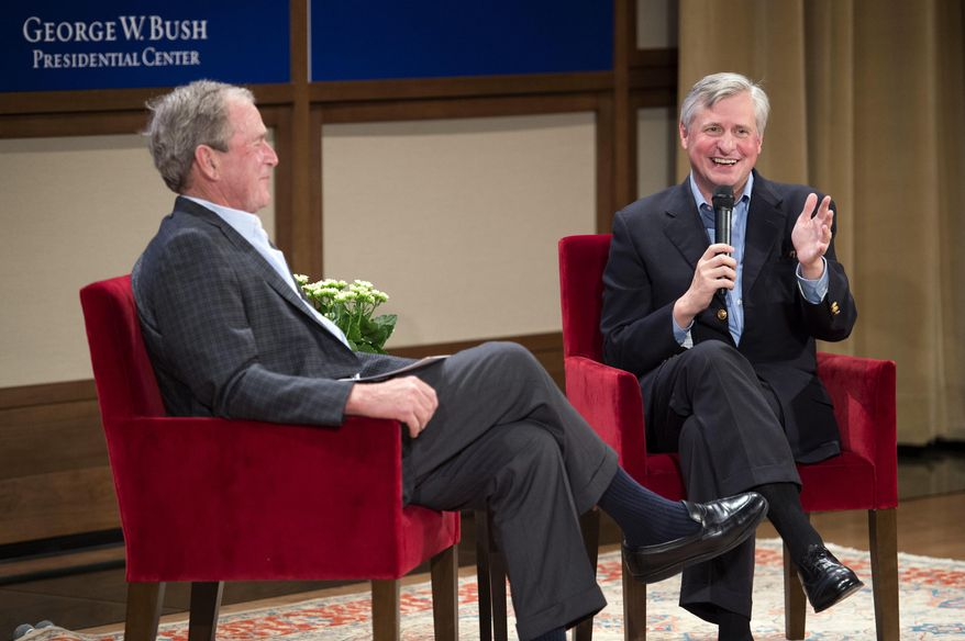 Pulitzer Prize-winning author Jon Meacham, right, discusses his biography of former President George H. W. Bush with Bush's son, former President George W. Bush, Sunday, Nov. 8, 2015, at the George W. Bush Presidential Center in Dallas. (AP Photo/Jeffrey McWhorter) ** FILE **