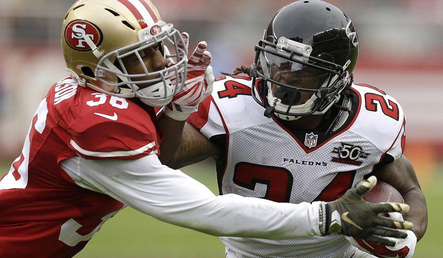 Atlanta Falcons running back Devonta Freeman (24) runs against San Francisco 49ers defensive back Dontae Johnson (36) during the first half of an NFL football game in Santa Clara, Calif., Sunday, Nov. 8, 2015. (AP Photo/Ben Margot)