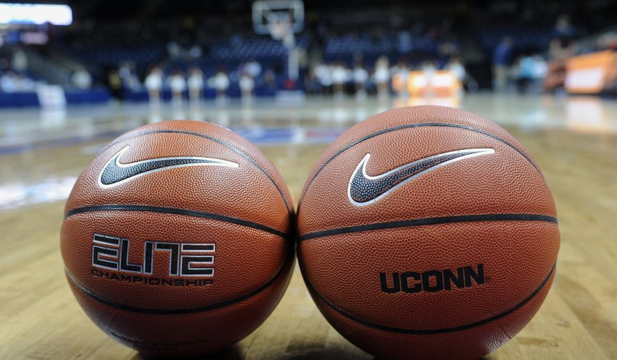 A women's college basketball, left, and men's college basketball are displayed before an NCAA college exhibition basketball game between Connecticut and Vanguard, Sunday, Nov. 8, 2015, in Storrs, Conn. UConn will be using some experimental rules, including a men's basketball, a 24-second shot clock, and the international 3-point line during the matchup. (AP Photo/Jessica Hill)